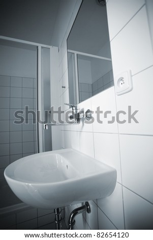 a simple bathroom in blue - stock photo