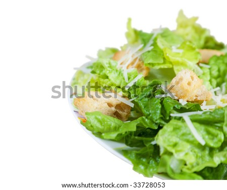 A simple Caesar salad with shallow depth of field.  Clipping path. - stock photo