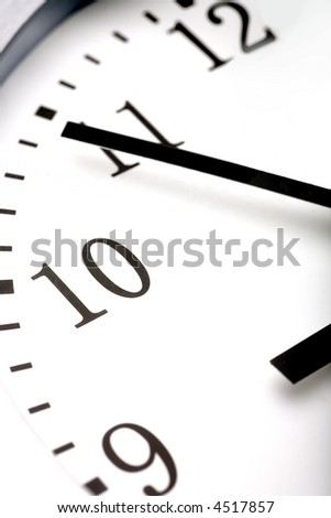 A simple close-up shot of a clock. - stock photo