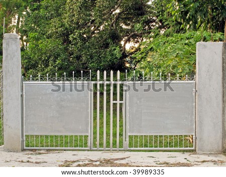 A simple gate in the farm - stock photo