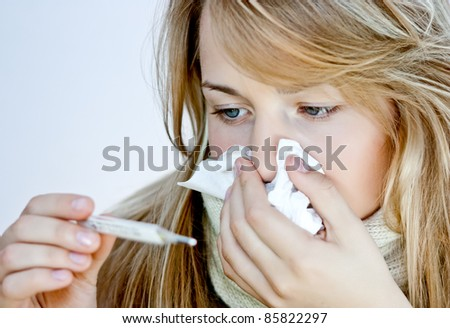 a simple girl with a thermometer - stock photo