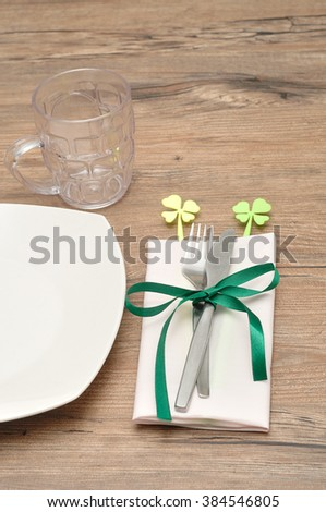 A simple table setting for St Patrick's day festivities  - stock photo