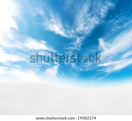 A simple tranquil beautiful S-curved horizon with blue sky and snowy hills. - stock photo