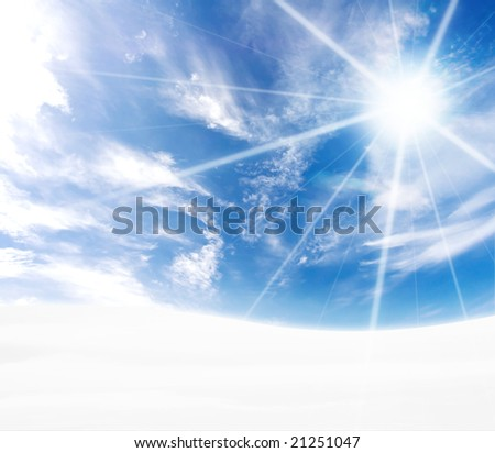 A simple tranquil beautiful S-curved horizon with blue sky and winter snow. Freezing feel with sun flare. - stock photo