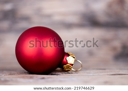 A Singel Red Christmas Ball on Wood, Macro Christmas or Winter Background with Copy Space - stock photo