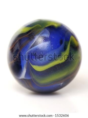 A Single Blue and Green Glass Marble Isolated on White