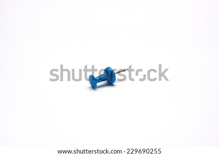 A single blue push pin on a white background - stock photo