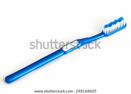 A Single Blue Toothbrush Isolated on White Background - stock photo