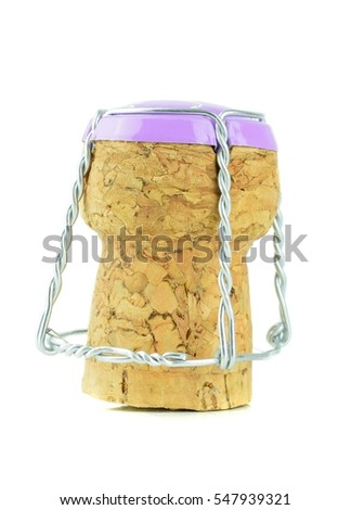 A single champagne cork with metal cap standing on a white background