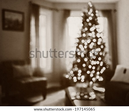 A single Christmas tree with small lights in front of a window. - stock photo