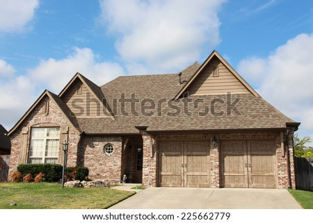 A single family home made from brick and stone - stock photo