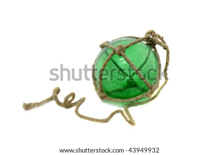 A Single glass fishing buoy used to keep fishing nets floating. This is an old glass antique. They use plastic ones now. Isolated on white background. - stock photo