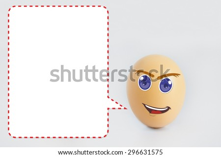 A single happy eggs with smiling faces with speech bubble for text caption. Isolated on a white background - stock photo