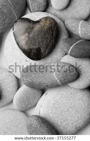 A single heart shaped pebble on a nice shingle beach - stock photo