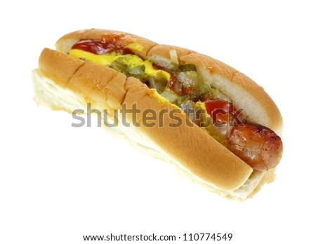 A single hot dog loaded in a steamed roll.