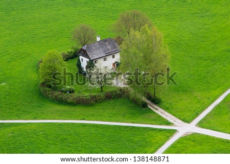 A single house surrounded by grass - stock photo