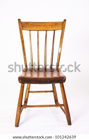 A single isolated antique hand made wood chair. - stock photo