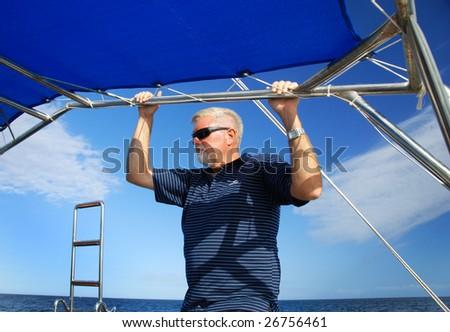 a Single man sailing on the sea - stock photo