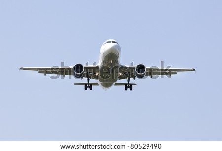 a single plane in a sky - stock photo
