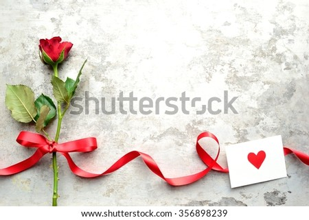A single red rose with red heart message card.Image of  Valentines day - stock photo