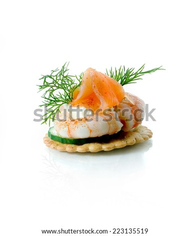 A single Seafood Salad Canape against a white background. Copy space. - stock photo