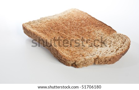 a single slice of brown toast isolated on white