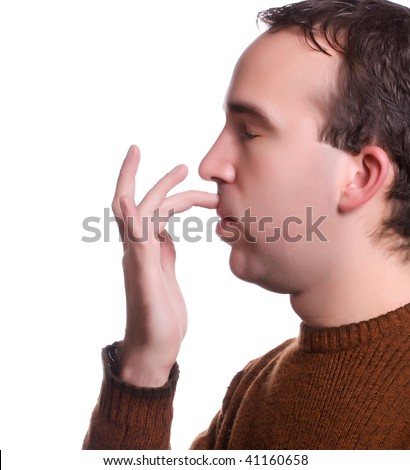 A single step in the Emotional Freedom Technique where you tap the area between your top lip and your nose to help relieve various ailments - stock photo