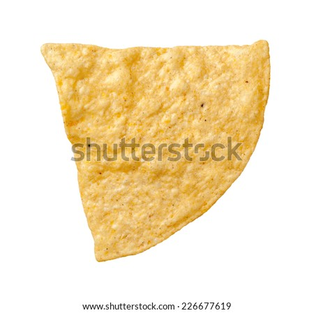 A single tortilla chip isolated on a white background. Tortillas are a salty snack associated with parties, and watching sporting events, often served with salsa dip.  - stock photo