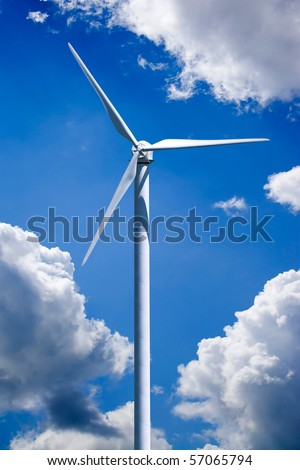 A single wind turbine over a cloud filled blue sky.  Clipping path is included for easy isolation of the turbine. - stock photo