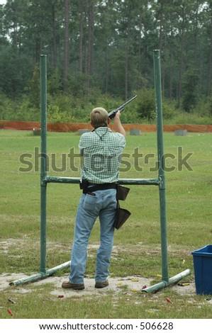 A skeet shooter hits his clay. - stock photo