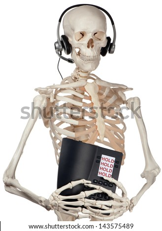 A skeletal phone operator holds a phone permanently on hold. - stock photo