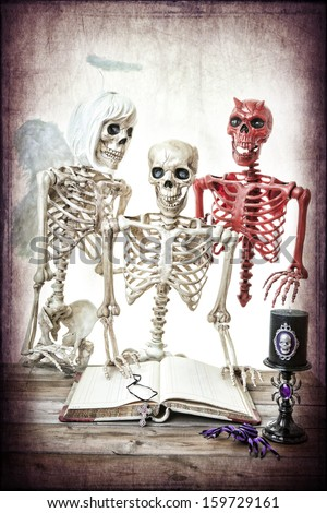 A skeleton man being coaxed by his good and bad side.  Classic good versus evil. - stock photo