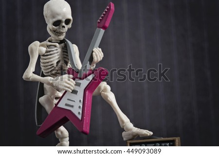 A Skeleton solo with his electric guitar - stock photo