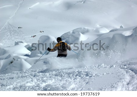 a skier atacking the giant's cascade glacier  on the valley blanche on the Mt blanc in powder snow - stock photo