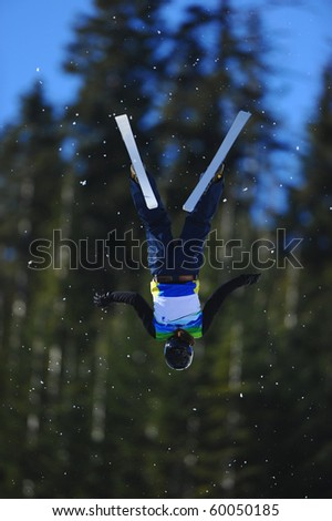 A skier does a flip in the air.