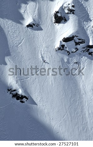 a skier making a  turn on a near vertical snow wall during the 2009 freeride extreme world championship finals - stock photo