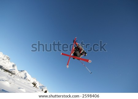 A skier shows off his moves in Whistler, BC. - stock photo