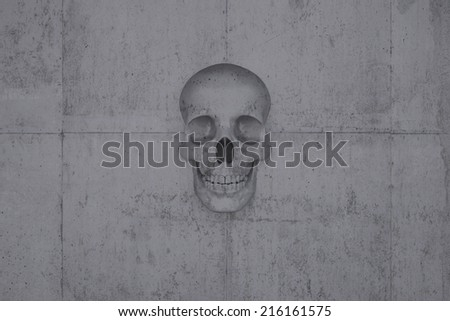 A skull on a wall of concrete symbol for doom and cataclysm