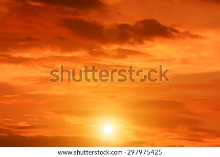 A sky filled with puffy brown and orange tinted clouds. - stock photo