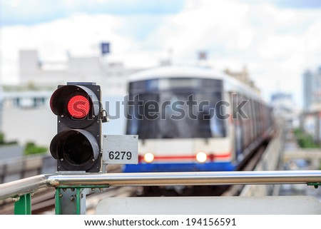 A sky modern train arrives ,station park -Bangkok red stop ,:	train arriving stop to next station ,blue sky the nice day