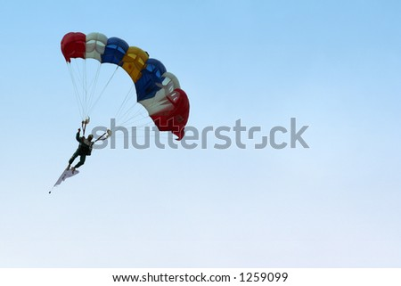 A skydiver parachuting down from the sky.