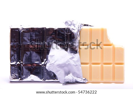 A slab of white creamy chocolate in a silver foil rapper on a white background. - stock photo