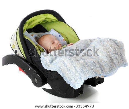 A sleeping baby in an infantm carrier/car seat.  Isolated on white. - stock photo