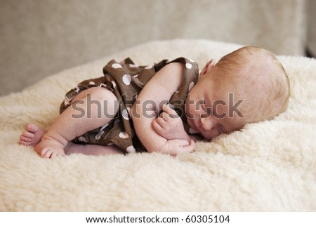 A sleeping three week old baby girl, horizontal with soft focus - stock photo