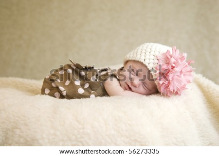 A sleeping three week old baby girl with soft focus - stock photo