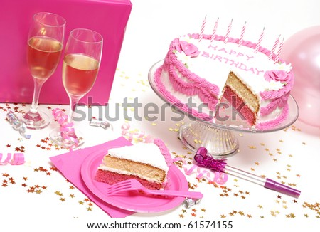A slice in front of the birthday cake it came from. - stock photo
