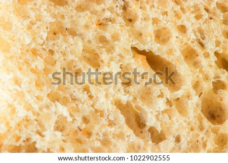 A slice of brown bread close up