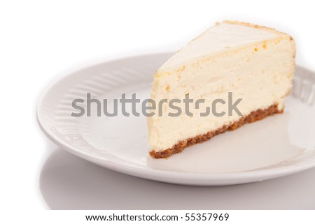 A slice of cheesecake on a white plate - stock photo
