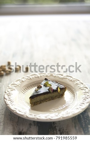 A slice of chocolate and pistachio vegan cake