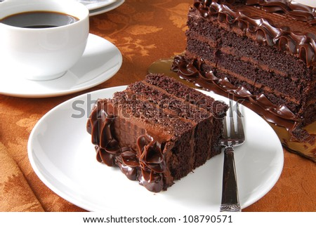 A slice of chocolate cake with coffee - stock photo